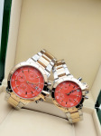 Tommy Hilfiger Couple Orange Dial & Gold And Silver -Toned Chronograph Watch