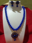 Beautiful Blue Pearl Necklace With Floral Pendant.